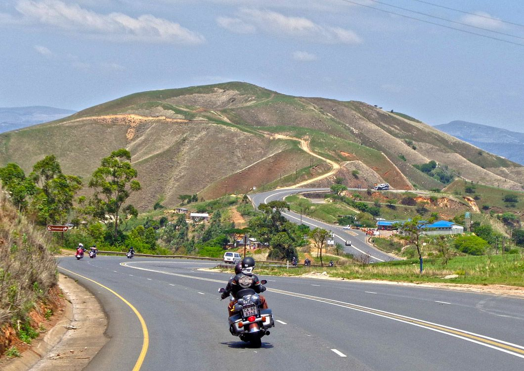 south african winding road with harley riders