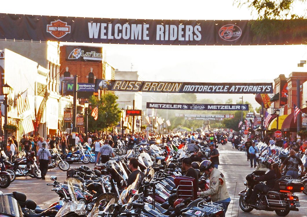 Harley Davidson motorcycles lined up sturgis rally