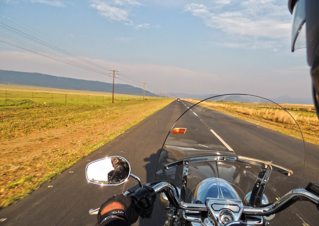 close up picture harley davidson motorcycle straight road