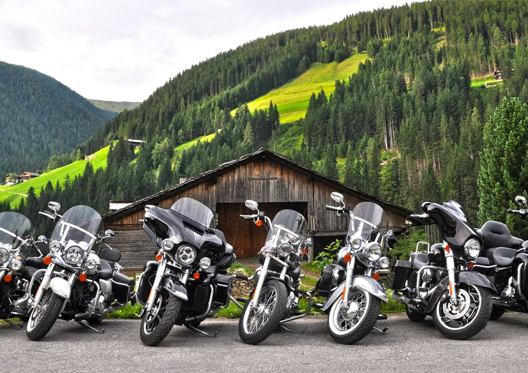 Harleys in front of a barn - Route of the Alps