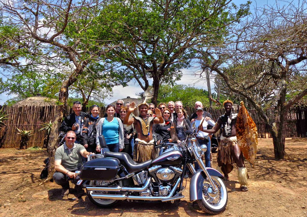 harley davidson motorcycle with west forever riders in a south african village